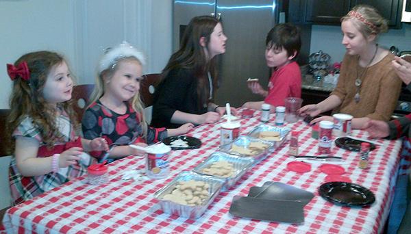 Grandkids making Christmas cookies.